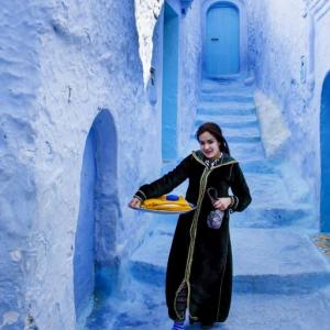 A YOUNG LADY IN THE TOWN OF BLUES CHEFCHAOUEN MOROCCO - 0